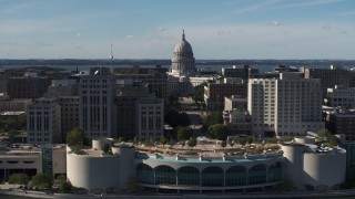 DX0002_160_017 - 5.7K stock footage aerial video pass by office buildings and focus on the capitol building in Madison, Wisconsin