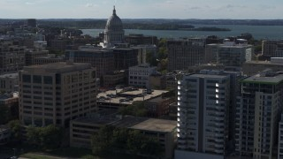 DX0002_160_019 - 5.7K stock footage aerial video fly near office buildings and focus on the capitol building in Madison, Wisconsin