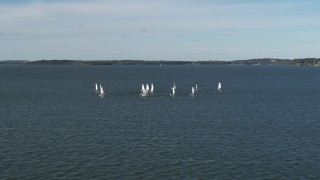 DX0002_160_037 - 5.7K stock footage aerial video of circling a group of sailboats on Lake Mendota, Madison, Wisconsin