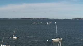 DX0002_160_038 - 5.7K stock footage aerial video an orbit of a group of sailboats on Lake Mendota, Madison, Wisconsin