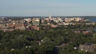 DX0002_161_001 - 5.7K stock footage aerial video a view of the capitol dome from a residential neighborhood, Madison, Wisconsin