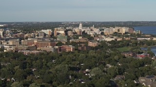 DX0002_161_002 - 5.7K stock footage aerial video a stationary view of the capitol dome from a residential neighborhood, Madison, Wisconsin