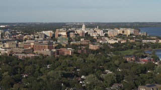 DX0002_161_003 - 5.7K stock footage aerial video of the capitol dome and downtown seen from a residential neighborhood, Madison, Wisconsin