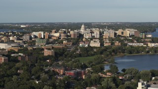 DX0002_161_004 - 5.7K stock footage aerial video wide view of the capitol dome and downtown seen from a residential neighborhood, Madison, Wisconsin
