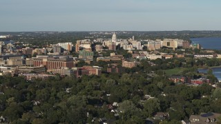 DX0002_161_006 - 5.7K stock footage aerial video fly away from and by the capitol dome and downtown seen from homes, Madison, Wisconsin