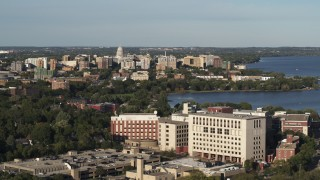 DX0002_161_008 - 5.7K stock footage aerial video wide view of the capitol dome and downtown seen from hospital, Madison, Wisconsin