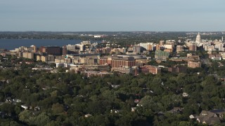 DX0002_161_010 - 5.7K stock footage aerial video of orbiting a hospital near downtown, Madison, Wisconsin
