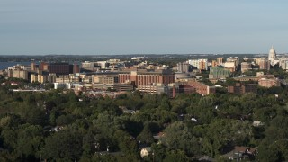 DX0002_161_012 - 5.7K stock footage aerial video of orbiting a hospital near downtown during descent, Madison, Wisconsin