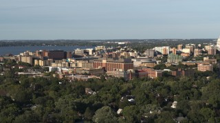DX0002_161_013 - 5.7K stock footage aerial video of orbiting a hospital near downtown during ascent, Madison, Wisconsin