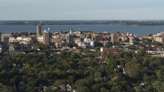 DX0002_161_015 - 5.7K stock footage aerial video of orbiting the lakeside university campus, Madison, Wisconsin