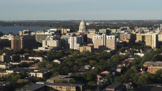 DX0002_161_019 - 5.7K stock footage aerial video ascend and flyby the capitol dome and downtown buildings, Madison, Wisconsin