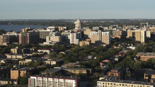 DX0002_161_020 - 5.7K stock footage aerial video flying away from and past the capitol dome and downtown buildings, Madison, Wisconsin