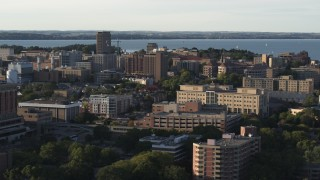 DX0002_161_023 - 5.7K stock footage aerial video of slowly flying by university campus buildings, Madison, Wisconsin
