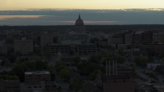 DX0002_162_001 - 5.7K stock footage aerial video of flying away from the capitol dome at sunset, Madison, Wisconsin