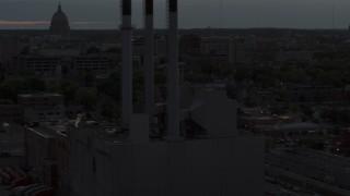 DX0002_162_011 - 5.7K stock footage aerial video orbit power plant smoke stacks at twilight, Madison, Wisconsin