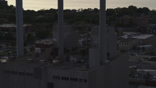 DX0002_162_012 - 5.7K stock footage aerial video orbit smoke stacks at a power plant at twilight, Madison, Wisconsin