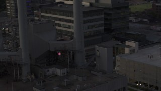 DX0002_162_013 - 5.7K stock footage aerial video close orbit of smoke stacks at a power plant at twilight, Madison, Wisconsin