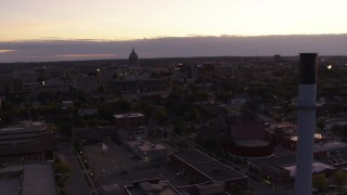 DX0002_162_020 - 5.7K stock footage aerial video flyby capitol dome to reveal smoke stacks at twilight, Madison, Wisconsin