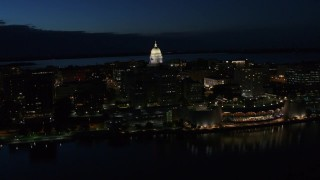 DX0002_162_022 - 5.7K stock footage aerial video orbit capitol dome to reveal convention center at twilight, Madison, Wisconsin