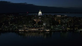 DX0002_162_023 - 5.7K stock footage aerial video orbit capitol dome and convention center at twilight, Madison, Wisconsin