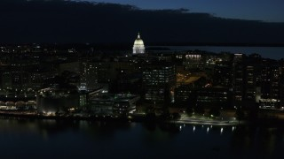DX0002_162_024 - 5.7K stock footage aerial video approach capitol dome from the lake at twilight, Madison, Wisconsin