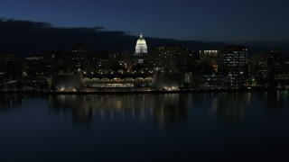 DX0002_162_025 - 5.7K stock footage aerial video orbit capitol dome and reveal the convention center at twilight, Madison, Wisconsin