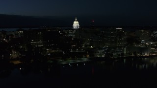DX0002_162_027 - 5.7K stock footage aerial video a view of capitol dome from the lake at twilight, Madison, Wisconsin