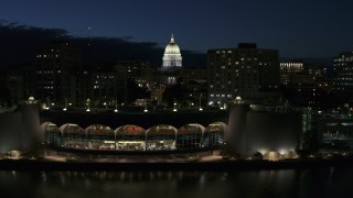 DX0002_162_028 - 5.7K stock footage aerial video a view of capitol dome from the convention center at twilight, Madison, Wisconsin
