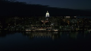 DX0002_162_032 - 5.7K stock footage aerial video a stationary view and approach to the capitol dome and convention center at night, Madison, Wisconsin