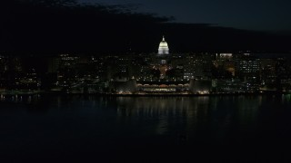 DX0002_162_038 - 5.7K stock footage aerial video of flying away from the convention center and capitol in downtown at night, Madison, Wisconsin