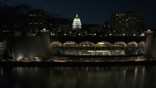 DX0002_162_040 - 5.7K stock footage aerial video fly over the convention center and orbit capitol at night, Madison, Wisconsin