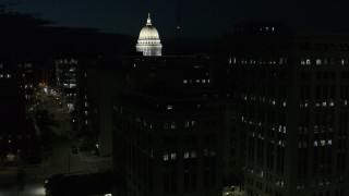 DX0002_162_041 - 5.7K stock footage aerial video view of capitol dome while descending by building at night, Madison, Wisconsin