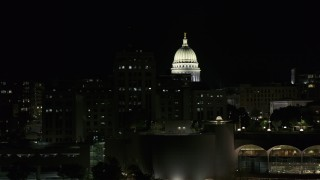DX0002_162_047 - 5.7K stock footage aerial video flyby State Office Building to reveal capital dome at night, Madison, Wisconsin