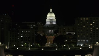 DX0002_162_050 - 5.7K stock footage aerial video focus on the capital at night, ascend from convention center, Madison, Wisconsin