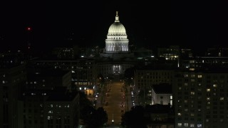 DX0002_162_051 - 5.7K stock footage aerial video a stationary view of the capital building at night, Madison, Wisconsin