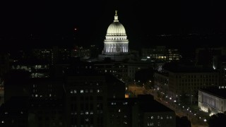 DX0002_162_052 - 5.7K stock footage aerial video slowly orbit the capital building at night, Madison, Wisconsin
