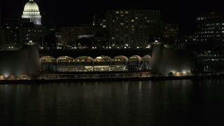 DX0002_162_061 - 5.7K stock footage aerial video fly toward the convention center at night, Madison, Wisconsin