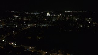 DX0002_163_007 - 5.7K stock footage aerial video wide orbit of Wisconsin State Capitol and downtown buildings at night, Madison, Wisconsin