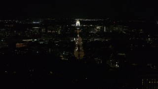 DX0002_163_008 - 5.7K stock footage aerial video wide orbit of Wisconsin State Capitol seen from Washington Ave at night, Madison, Wisconsin