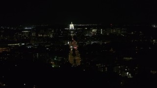 DX0002_163_012 - 5.7K stock footage aerial video of the state capitol at the end of Washington Ave at night seen during descent, Madison, Wisconsin