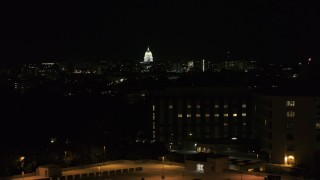 DX0002_163_014 - 5.7K stock footage aerial video of the state capitol dome at night, seen from hospital, Madison, Wisconsin