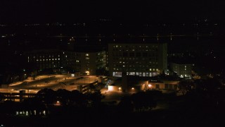 DX0002_163_017 - 5.7K stock footage aerial video of an orbit of a hospital at night, Madison, Wisconsin