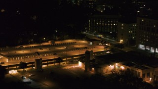 DX0002_163_018 - 5.7K stock footage aerial video of an orbit of a hospital and parking garage at night, Madison, Wisconsin