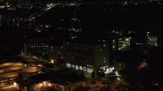 DX0002_163_021 - 5.7K stock footage aerial video orbit a hospital complex at night, Madison, Wisconsin