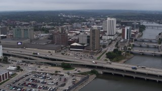 DX0002_164_004 - 5.7K stock footage aerial video a view of apartment high-rise and office buildings near bridges and river, Downtown Cedar Rapids, Iowa