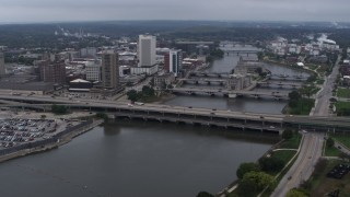 DX0002_164_006 - 5.7K stock footage aerial video a reverse view of bridges spanning the river by Downtown Cedar Rapids, Iowa