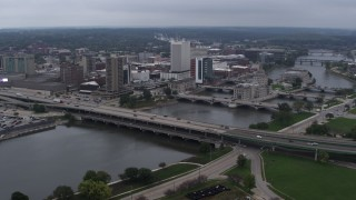DX0002_164_008 - 5.7K stock footage aerial video approach and flyby bridges spanning the river beside Downtown Cedar Rapids, Iowa