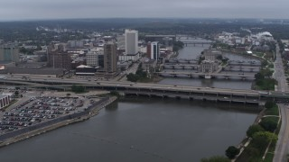 DX0002_164_009 - 5.7K stock footage aerial video fly away from and flyby bridges spanning the river beside Downtown Cedar Rapids, Iowa