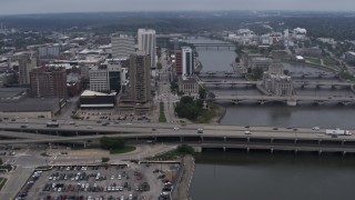 DX0002_164_010 - 5.7K stock footage aerial video approach apartment high-rise and bridges spanning the river, Downtown Cedar Rapids, Iowa
