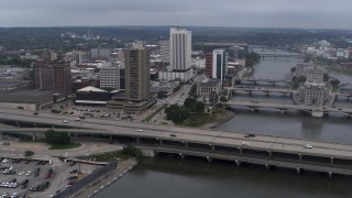 DX0002_164_011 - 5.7K stock footage aerial video reverse view of apartment high-rise and bridges spanning the river, Downtown Cedar Rapids, Iowa